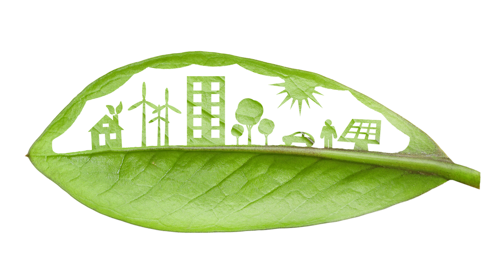 An image of green city concept through a leaf